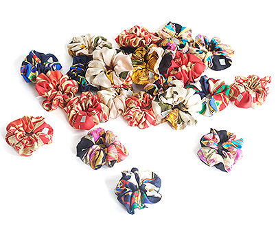 A collection of scrunchies made from vintage silk scarves